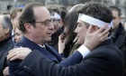 Hollande comforts Charlie Hebdo columnist Patrick Pelloux at the solidarity march. Photograph: Philippe Wojazer/AFP/Getty Images